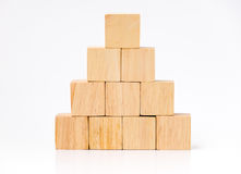 Close up at wood cube arrange in pyramid shape ,business concpt. Mock up Royalty Free Stock Images
