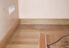 Wood Flooring. Skirting Board Oak Wooden Floor . Flooring with Wooden Batten Repair. CLose up on Wood Flooring. Skirting Board Oak Wooden Floor stock image