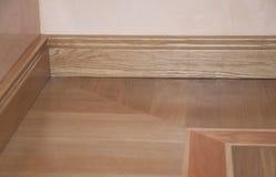 Close up on wooden batten repair on oak wood parquet installation stock photo
