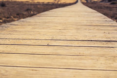 Close-up of wooden beach boardwalk path Royalty Free Stock Photos