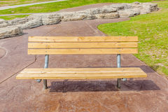 Close up wooden bench in national green park, for rest and relax Royalty Free Stock Image