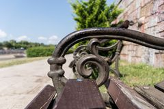 Wooden bench and stylish handle metal detail stock photo