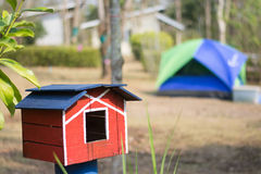 Close up wooden bird house with tent background Stock Photo