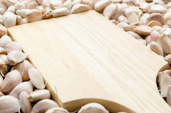 Close up wooden board with garlic cloves Stock Photos