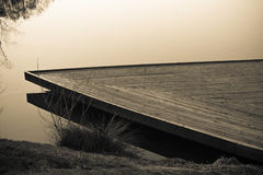 Close up of  wooden boat structure on the lake in black and white sepia Royalty Free Stock Photography