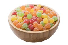 Wooden bowl of Gummy Fruit candy isolated on white background Royalty Free Stock Photography