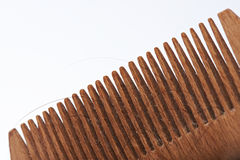 Close-up of wooden brush. With lost dark human hair Stock Image