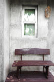 Close up wooden chair and wall Royalty Free Stock Photos