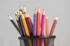 Close up of wooden colorful pencils, group of scattered crayons, isolate od white background stock image
