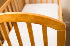 Close up of a Wooden Cot Frame. For a new baby Stock Photography