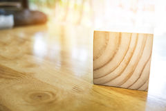 Close-up of wooden cube on table over blur abtract bokeh light b. Ackground Stock Photos