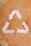 Close-up wooden cut and recycle symbol Stock Photos