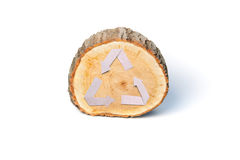 Close-up wooden cut and recycle symbol Stock Image