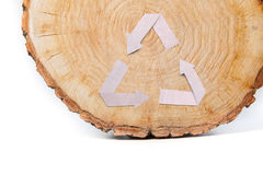 Close-up wooden cut and recycle symbol Stock Photo