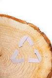 Close-up wooden cut and recycle symbol Royalty Free Stock Photography
