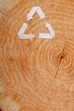 Close-up wooden cut and recycle symbol Royalty Free Stock Photo