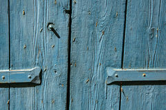 Close-up of wooden door and hinge painted blue, in the village of Lourmarin. In the Vaucluse department, Provence-Alpes-Côte d`Azur region, southeastern Stock Photography