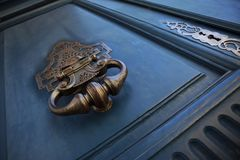 Close up of a wooden door and knocker royalty free stock photography
