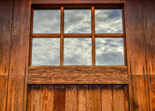 Close up of wooden door with window. Wooden door with windows that has reflection of the sky Stock Photo
