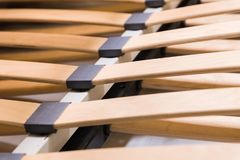 Close-up wooden elements of an arthopedic base of a double bed. Interior structure of furniture.  royalty free stock photo