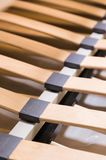 Close-up wooden elements of an arthopedic base of a double bed. Interior structure of furniture.  royalty free stock photos