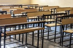 Schools benches or desks. Close up of wooden empty school studying benches or desk. Concept of back to school stock photo