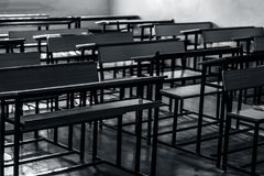 Schools benches or desks. Close up of wooden empty school studying benches or desk. Concept of back to school stock photography