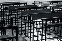 Schools benches or desks. Close up of wooden empty school studying benches or desk. Concept of back to school stock images