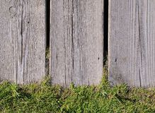 Close-up of wooden fence with green grass Stock Photography