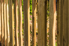 Close up of wooden fence, wood vertical slats. Vertical rough-hewn planks of wood, part of fence Royalty Free Stock Photos