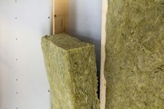 Close-up of wooden frame for future walls insulated with rock wool and fiberglass insulation staff for cold barrier. Comfortable w. Arm home, economy stock photo