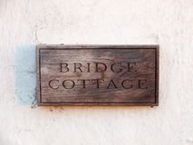 close up wooden house sign bridge cottage carved special unique royalty free stock image