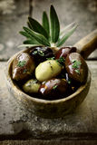Close-up of a wooden ladle with seasoned olives Royalty Free Stock Image