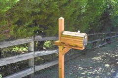 Close-up of wooden mailbox near farm fence in Texas, USA stock image