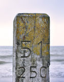 Close-up of a wooden pillar or pile at the beach Stock Photo