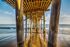 Close up of wooden poles of Malibu pier. California Royalty Free Stock Images