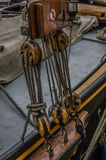 Close up of wooden pully blocks securing the rigging on sail boa Stock Photo