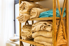 Close up of wooden rack with fleece plaids Royalty Free Stock Photos