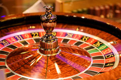 Close up of wooden roulette in casino, selective focus. Close up of wooden roulette in casino Royalty Free Stock Images