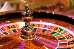 Close up of wooden roulette at the gambling house, selective focus. Close up of wooden roulette at the gambling house Stock Photo
