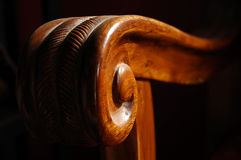 Close up of wooden sofa handle in morning light Royalty Free Stock Photo