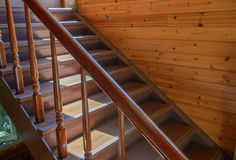 Close-up of wooden stairs in luxury house. Vintage stairs, selective focus on the wooden steps Royalty Free Stock Image
