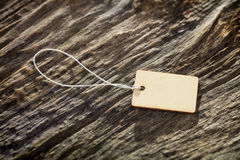 Close-up of wooden tag on white rope Royalty Free Stock Photography