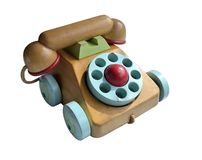 Close up of wooden toy telephone with coloured dials and wheels isolated on white background. Selective focus royalty free stock images
