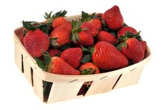 Tray of strawberries on a white background royalty free stock photography