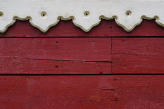 Close Up of wooden wall with part of wooden carved window frame Stock Photo