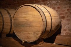 Wooden barrel in the basement stock images