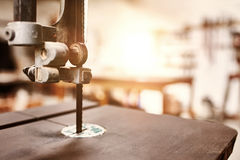 Close up of woodwork jig saw with workshop in background Stock Photography