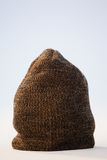Close-up of wooly hat. Against white background Royalty Free Stock Image