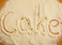 Close up of word cake written in flour Royalty Free Stock Photography